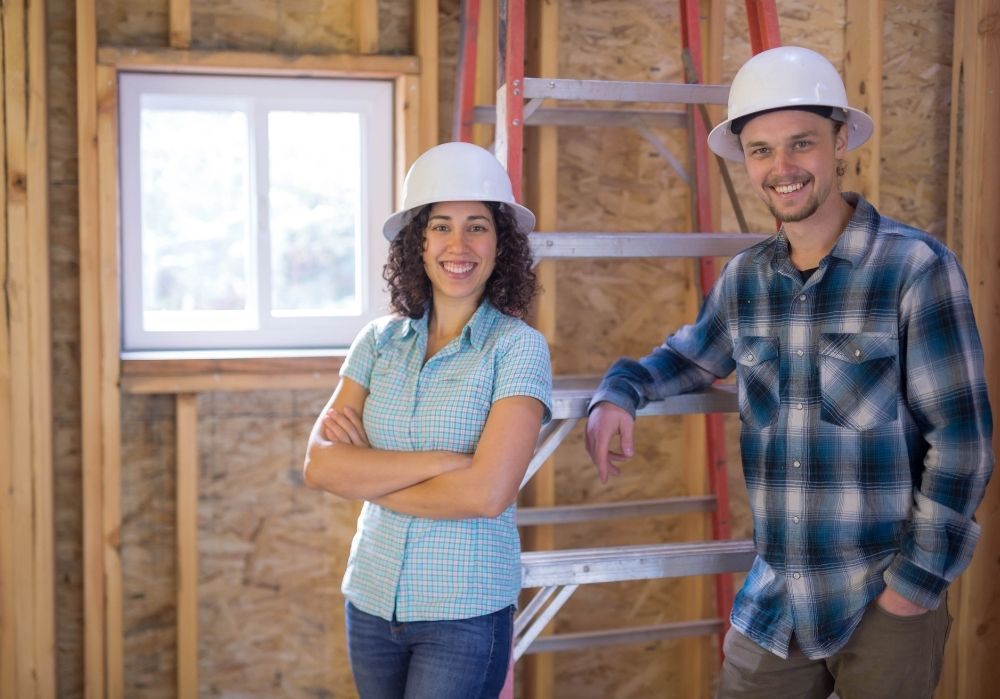 Two general contractors wearing hard hats